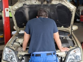 Mechanic Looking Under Hood