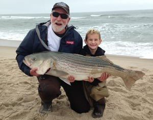 Watch This 6-Year-Old Boy Reel in a 43-Pound Striper