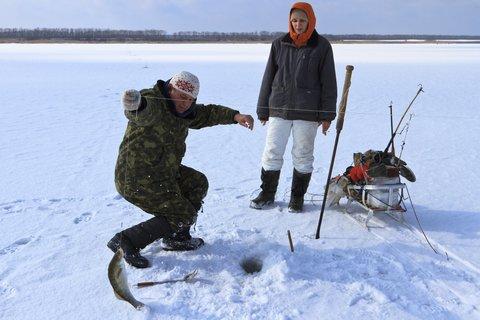 ice fishing couple