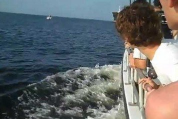 Watch An Oil Tanker Nearly Crush a Sport Boat