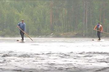 Watch Finnish Lumberjacks Ride Logs Like SUPs