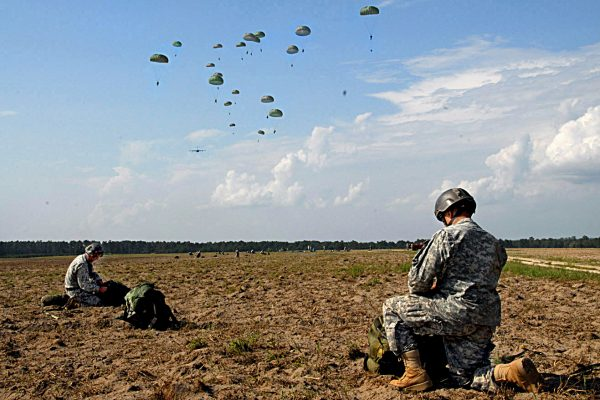 Members of the 75th Ranger Regiment gathers their parachutes after landing on Fryar Drop Zone Aug. 3 as part of a mass tactical airborne operation. More than 1,000 Rangers from all four of the Regiment's battalions participated in the jump, officially kicking off Ranger Rendezvous 2009. (Photo by Sgt. Tony Hawkins, USASOC PAO)